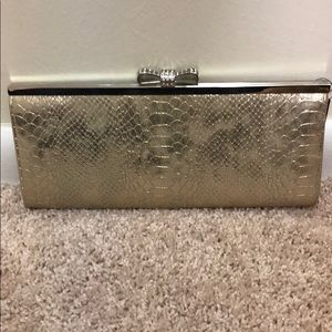 Brand new INC exotic gold clutch with tags